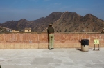A security guard overlooks the valley, Amber Fort, Jaipur.